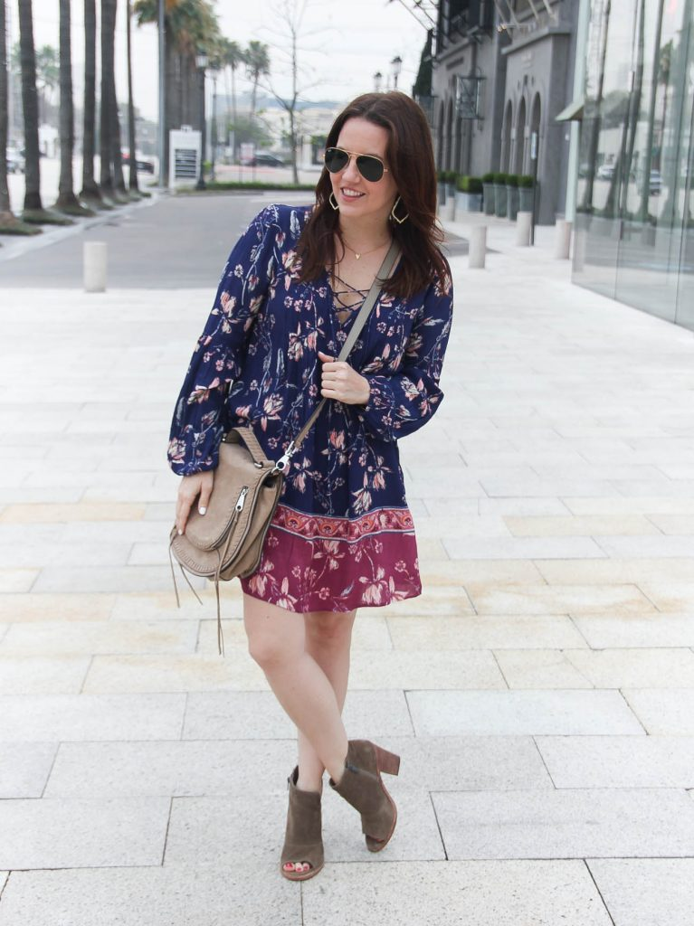 Houston fashion blogger Lady in Violet styles a spring outfit idea featuring a floral swing dress with peep toe booties.