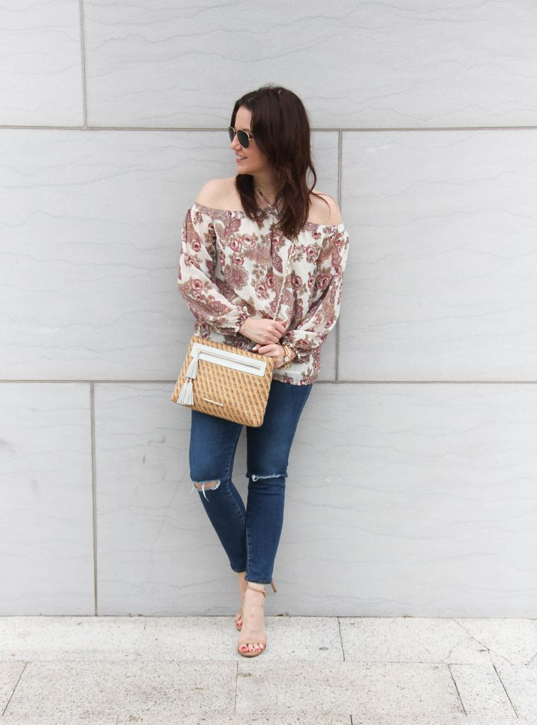 Lady in Violet, a Houston fashion blogger styles spring outfit idea featuring floral cold shouder top with distressed jeans.