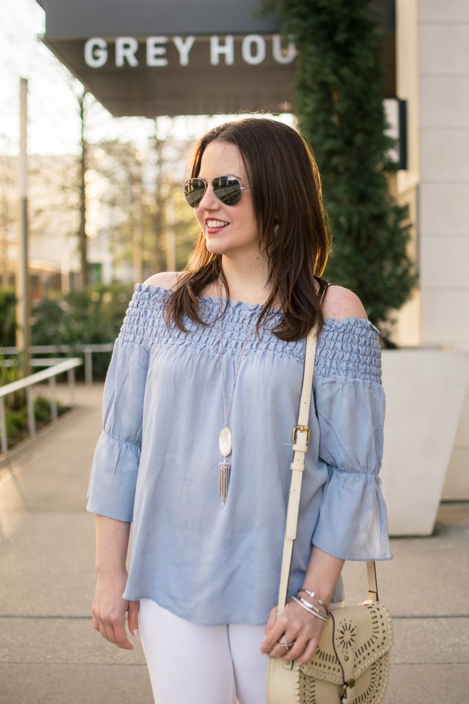 Karen Rock, a Houston based Style blogger wears a blue off the shoulder top with the Kendra Scott Rayne necklace in a spring outfit idea.