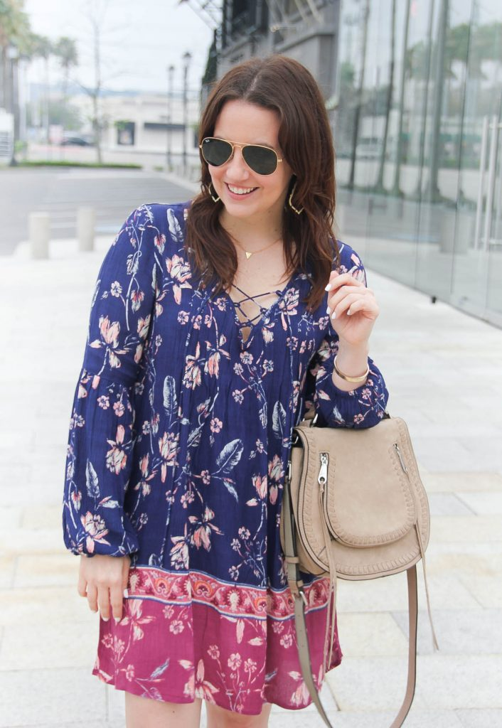 Lady in Violet, a Houston based Fashion Blogger wears boho chic style featuring a cute floral swing dress for a weekend outfit.