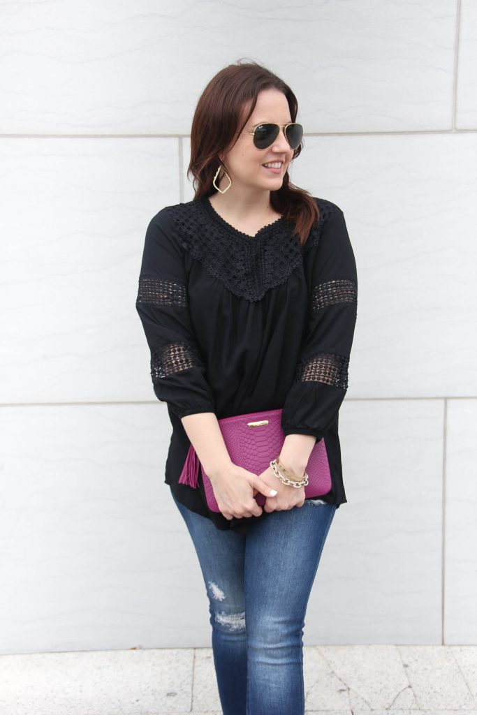 Lady in Violet, a Houston based fashion blogger wears a cute black top under $50 with distressed jeans under $100.