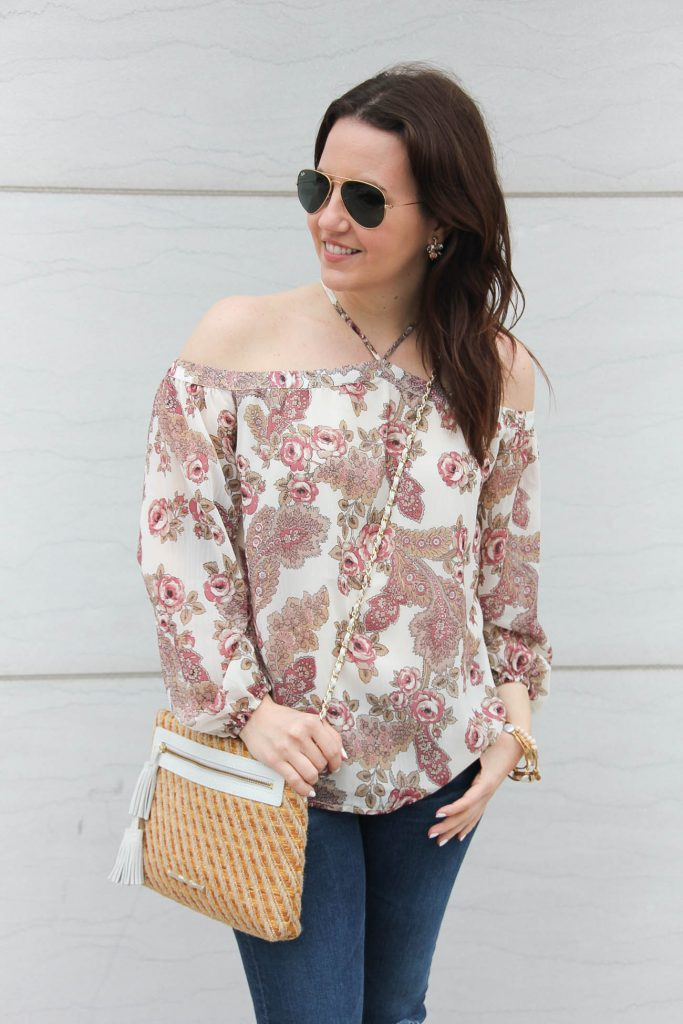 Houston fashion blogger wears a pink floral cold shoulder top with an Elaine Turner purse.