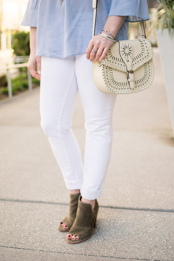 Lady in Violet, a Houston fashion blogger wears brown peep toe booties with white jeans for spring casual outfit inspiration.