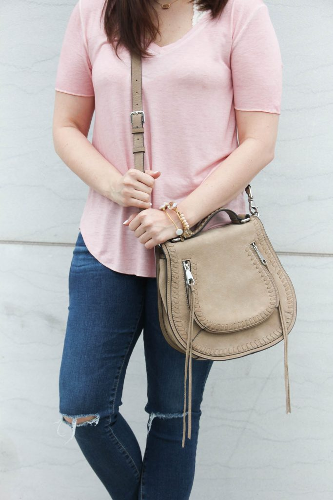Lady in Violet, a Houston Fashion blog shares a casual weekend outfit including a pink tshirt with distressed jeans and a saddle crossbody bag.