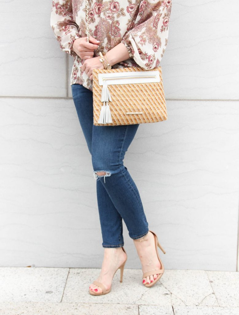 Houston fashion blogger lady in violet wears distressed jeans with heels for spring outfit inspiration.