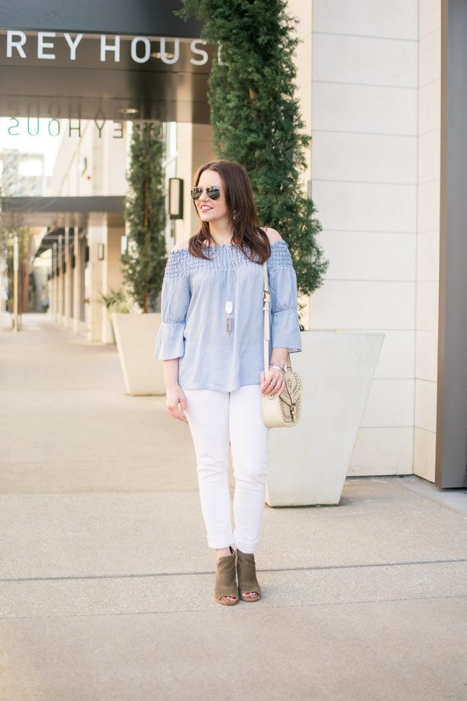 Houston fashion blogger wears a casual weekend outfit idea including white jeans, a blue off the shoudler top with brown ankle boots.