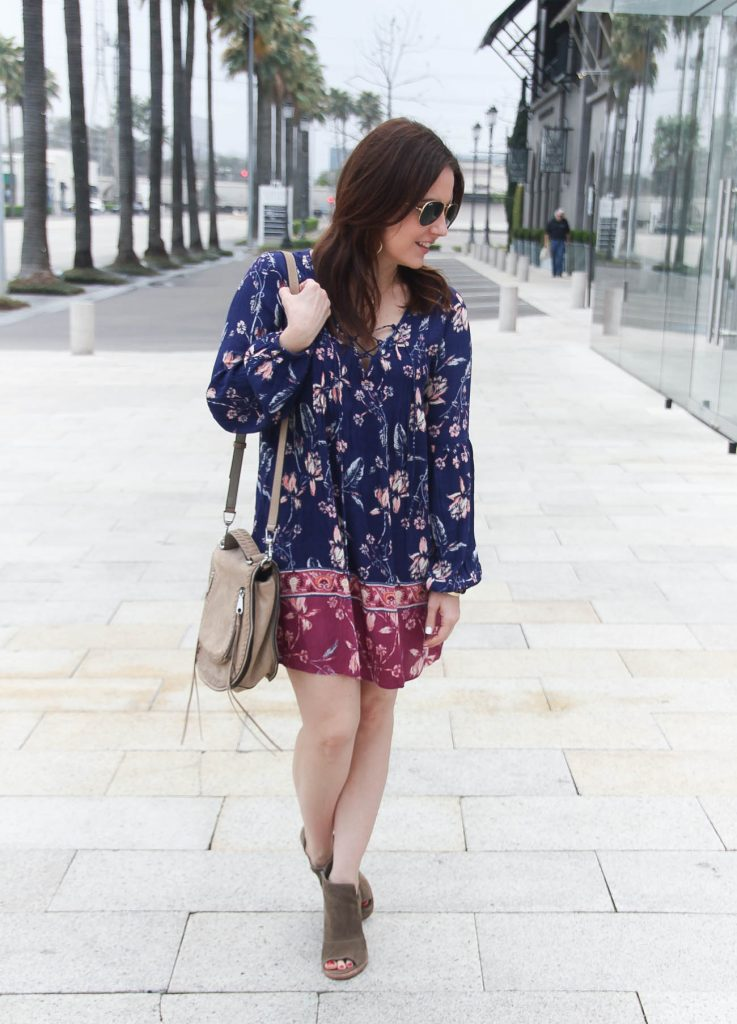 Houston fashion blogger styles a festival outfit idea including a boho floral swing dress with brown peep toe booties.