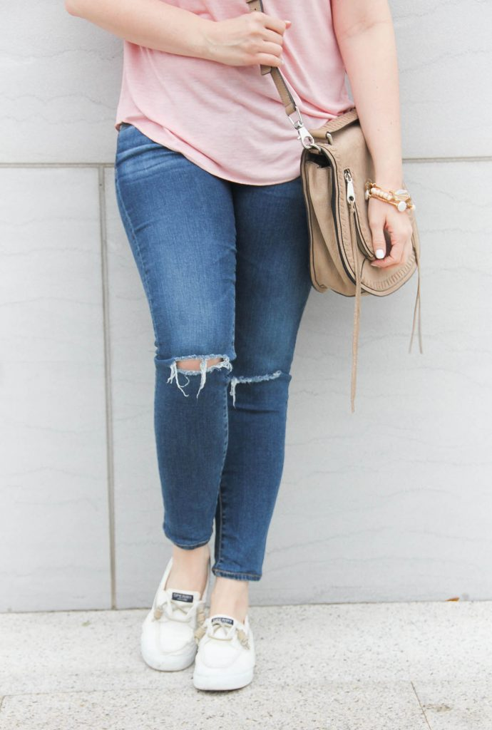 Lady in Violet of Houston wears AG distressed jeans with Sperry white sneakers for a road trip.