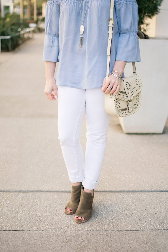 Houston fashion blogger wears spring outfit idea with bell sleeve blouse and white skinny jeans.