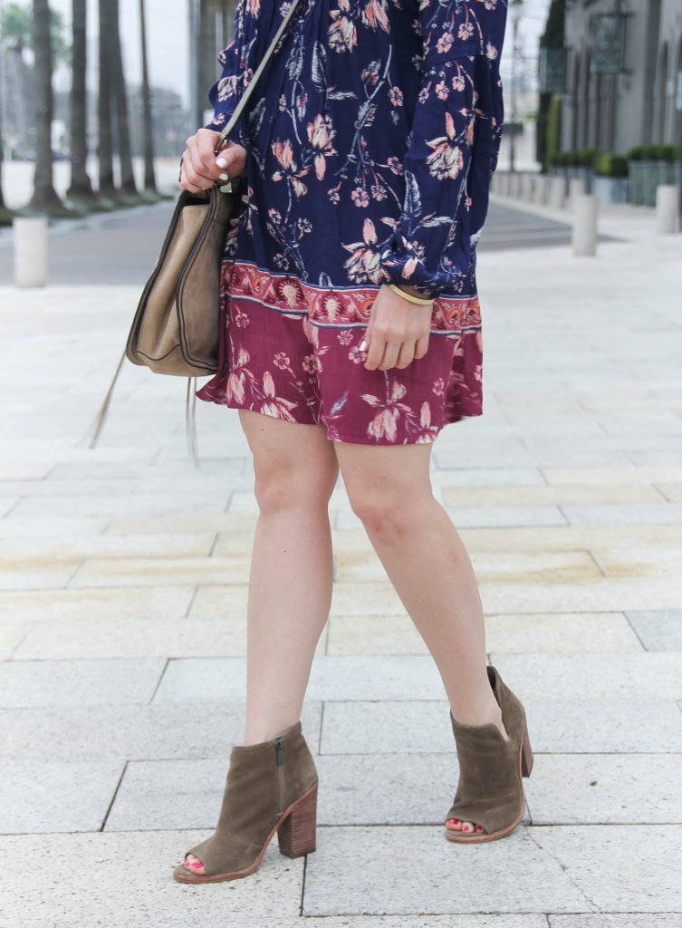Houston fashion blogger Lady in Violet shares how to wear booties with a dress.
