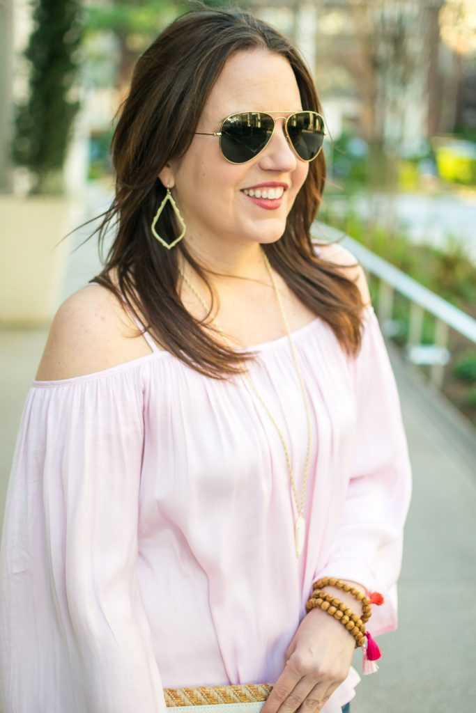 Houston fashion blogger Karen Rock styles a pink cold shoulder top for a weekend outfit.
