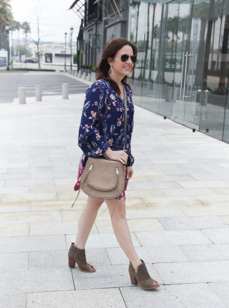 Houston fashion blogger styles boho chic outfit including a floral swing dress and booties.