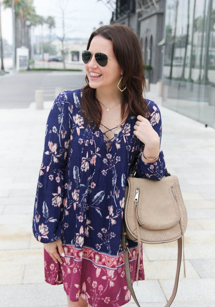 Lady in Violet, a Houston based blogger wears a boho chic dress with gold Kendra Scott earrings.
