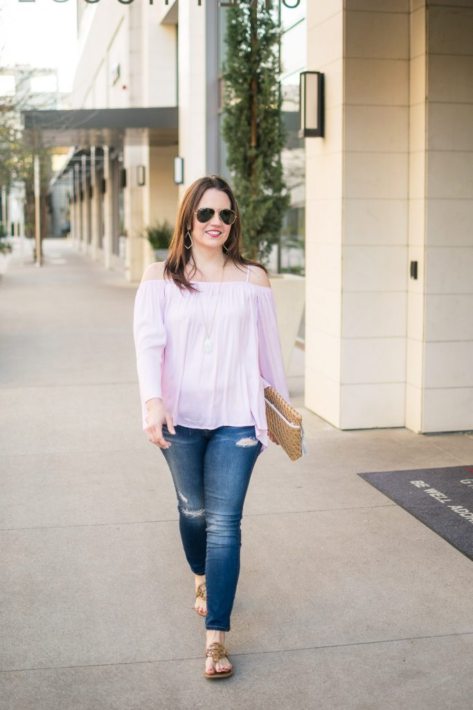 Casual weekend outfit ideas featuring distressed jeans and a pink cold shoulder top.