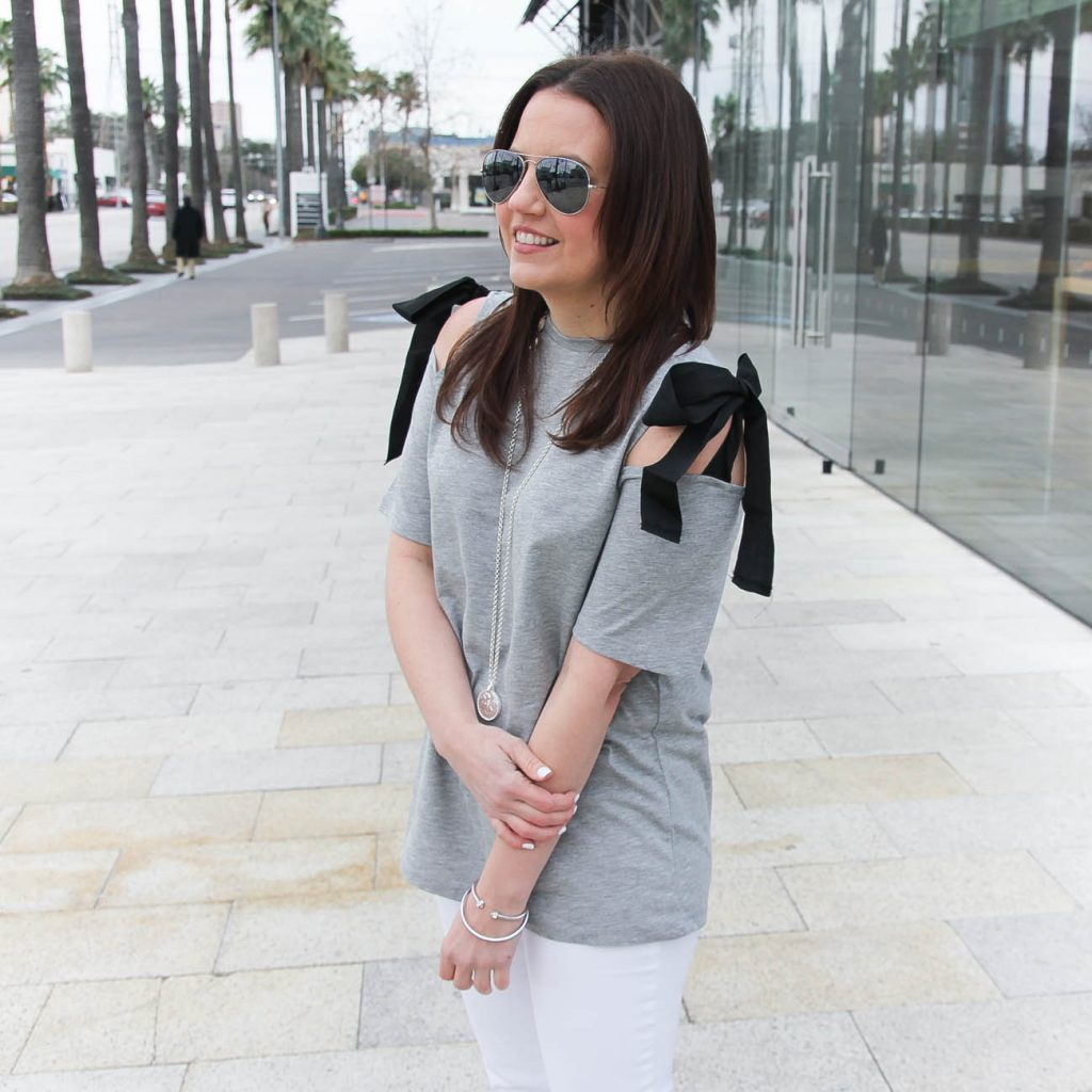 Lady in Violet, a Houston based fashion blogger, wears a gray cold shoulder tee with bows.