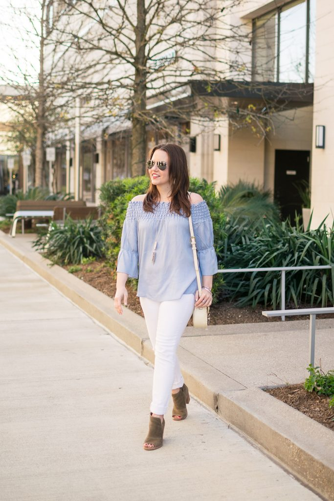 Fashion Blogger Karen Rock wears blue off the shoulder top with white jeans and booties for a weekend outfit idea.
