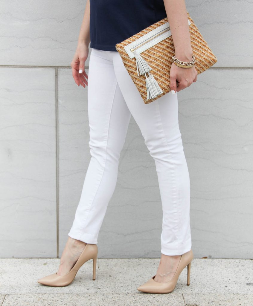 Houston fashion blogger shares a paige white denim review and carries the elaine turner straw tassel clutch.