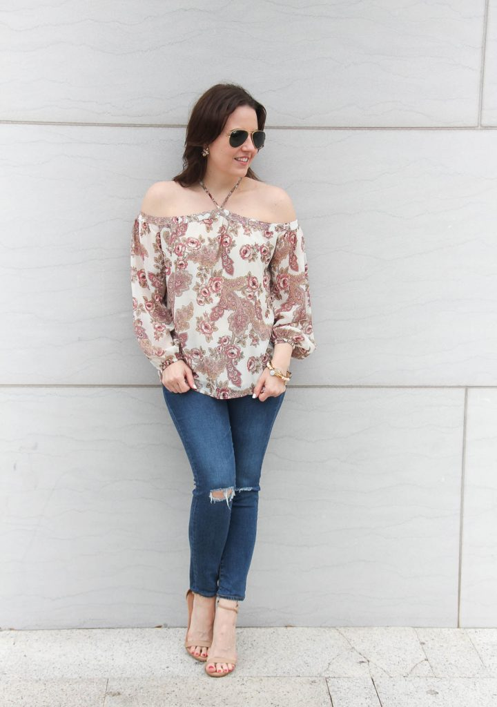Houston based blogger, Lady in Violet styles a casual weekend outfit including distressed jeans and a floral blouse.