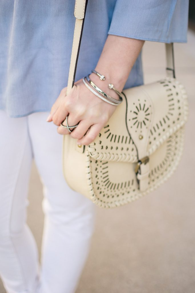 Houston fashion blogger carries the Sole Society kianna crossbody saddle bag in Ivory.
