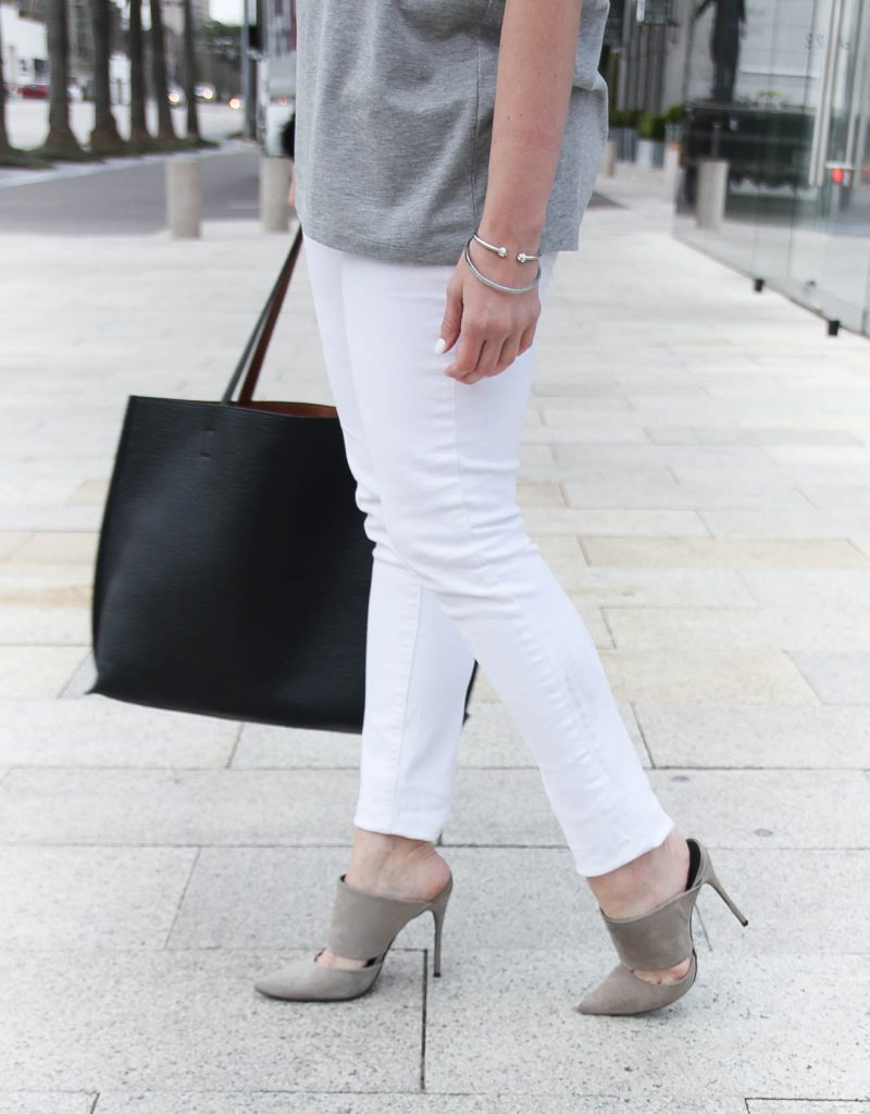 Karen Rock a Houston fashion blogger wears the perfect pair of white skinny jeans with gray suede mules.
