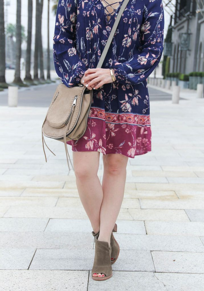 Lady in Violet, a Houston based fashion blogger shares what to wear to a festival including a swing dress and peep toe booties.