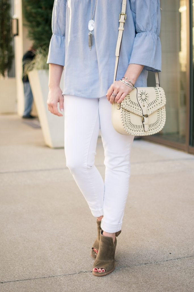 Houston blogger wears a spring outfit idea including a blue bell sleeve top with white skinny jeans and brown peep toe booties.