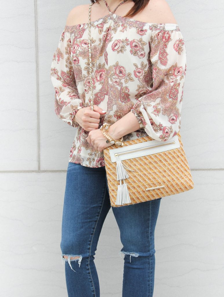 Lady in Violet shares spring outfit inspiration featuring a floral off the shoulder top with distress jeans and a spring must have bag.