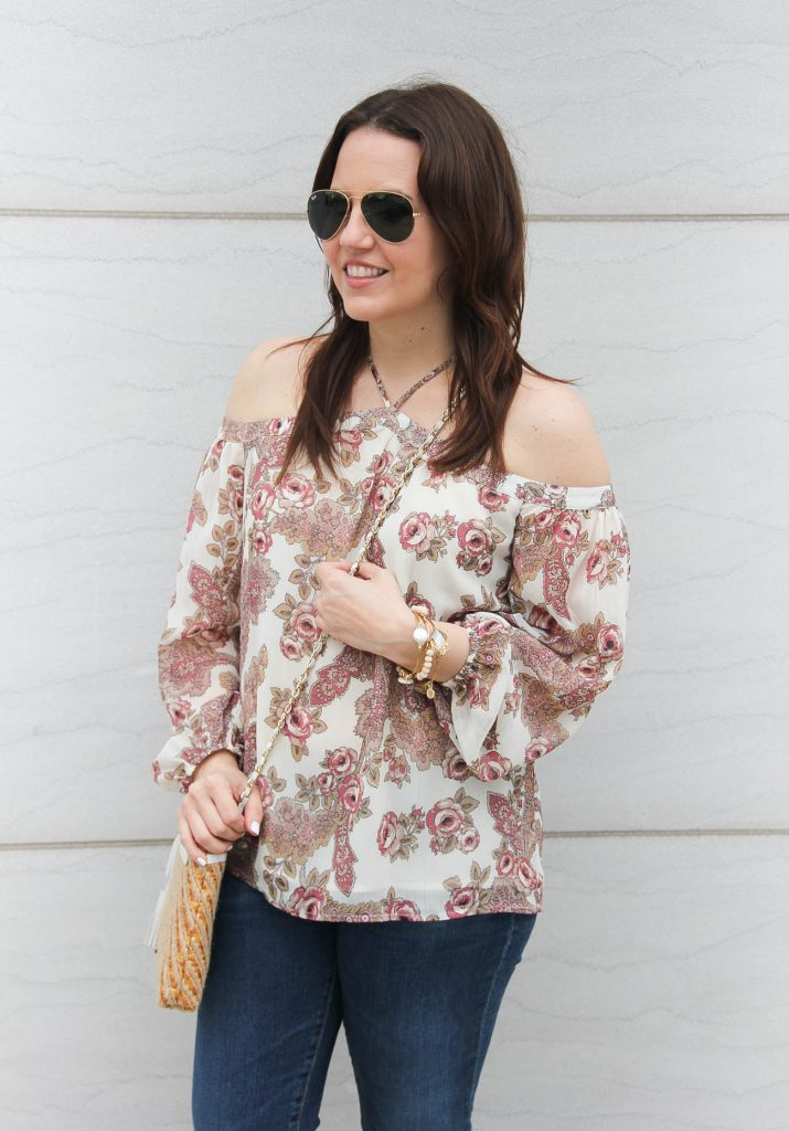 Lady in Violet, a houston based fashion blogger wears a cute floral cold shoulder top for spring.