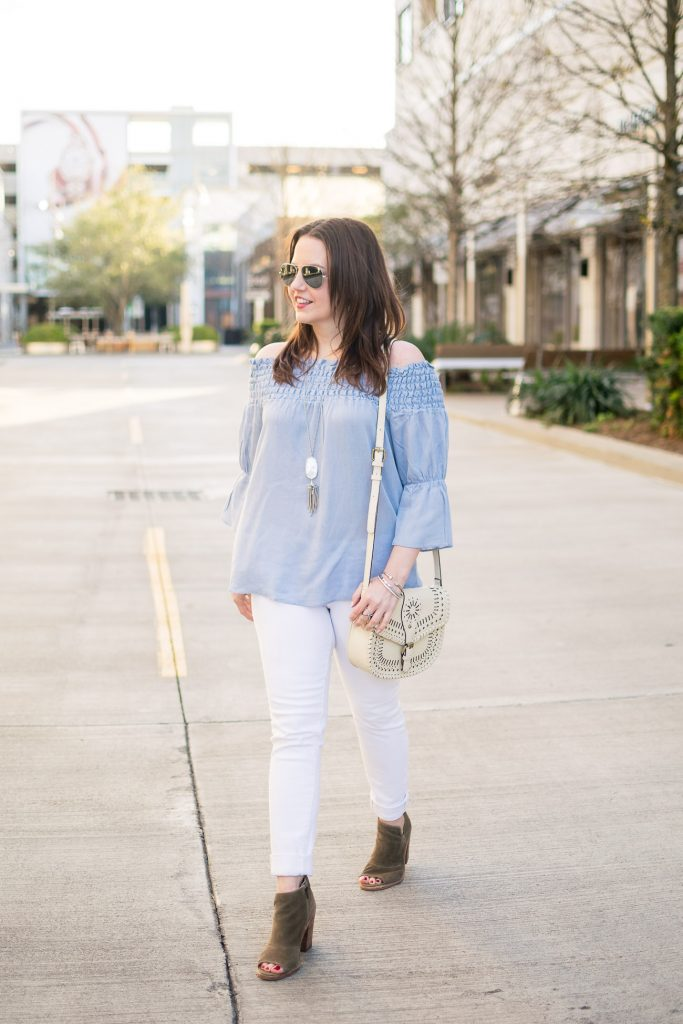 Houston fashion blogger Lady in Violet styles spring outfit inspiration featuring a blue top with white jeans.