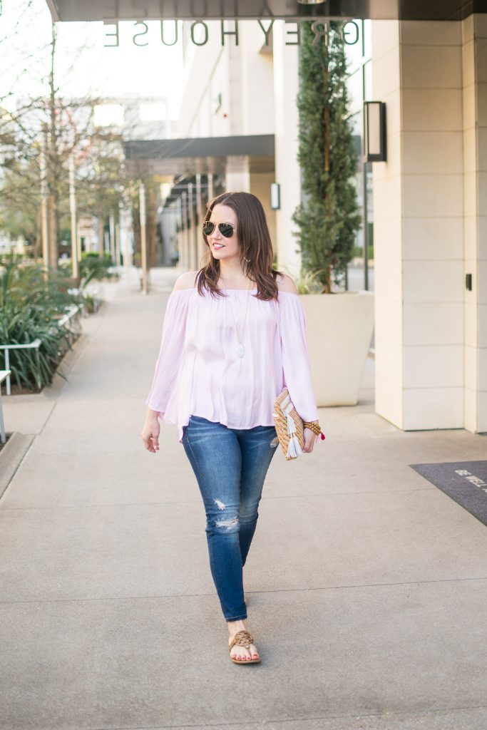 Houston fashion blogger wears a vince camuto cold shoulder top and distressed jeans with the Tory Burch miller sandals for a spring outfit idea.