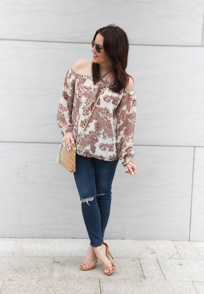 Lady in Violet, a Houston based style blogger wears a spring casual outfit idea including distressed jeans, a pink floral top, and nude sandals.