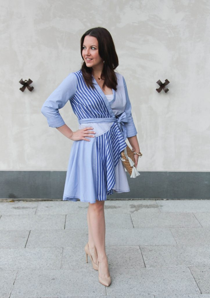 Houston fashion blogger wears an Anthropologie shirt dress that is a blue fit and flare style with nude heels.