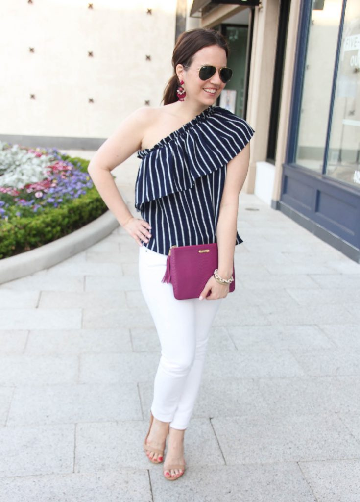 Houston fashion blogger wears a chic Spring outfit idea including a one shoulder top with white jeans.
