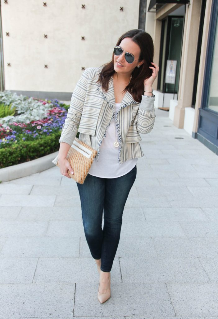 Houston fashion blogger styles a striped spring jacket with a white tank top and skinny jeans.