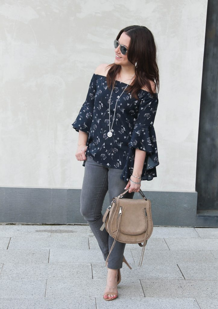 Houston fashion blogger wears a spring outfit idea including a bell sleeve off the shoulder top with gray jeans.