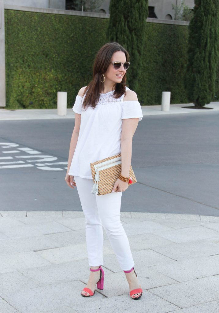 Houston fashion blogger styles a spring outfit idea featuring a white on white outfit with pink block heel sandals.