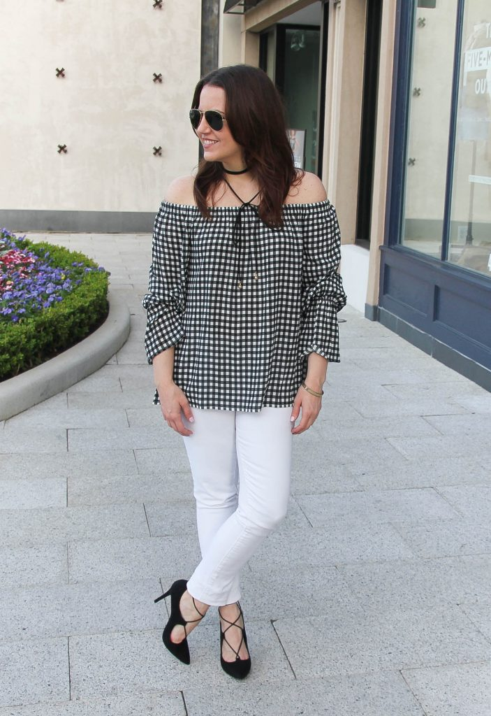 Houston fashion blogger shares spring outfit inspiration including a gingham off the shoulder top with white jeans and black lace up heels.