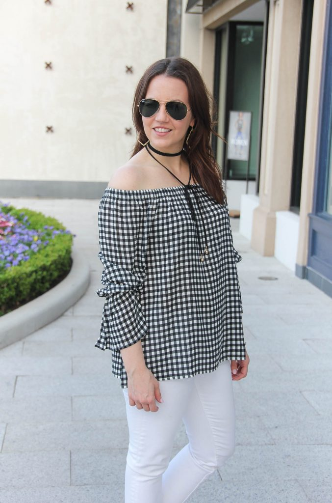 Houston style blogger wears a gingham off the shoulder top with a black wrap choker with long front ties.