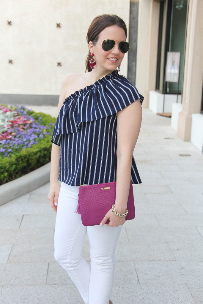 Lady in Violet, a Houston based style blogger, wears a navy striped one shoulder top with white jeans for a weekend outfit idea for Spring.