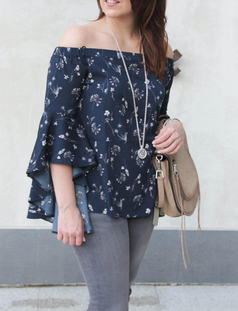 Houston fashion blogger styles spring outfit ideas including off the shoulder top with gray jeans.