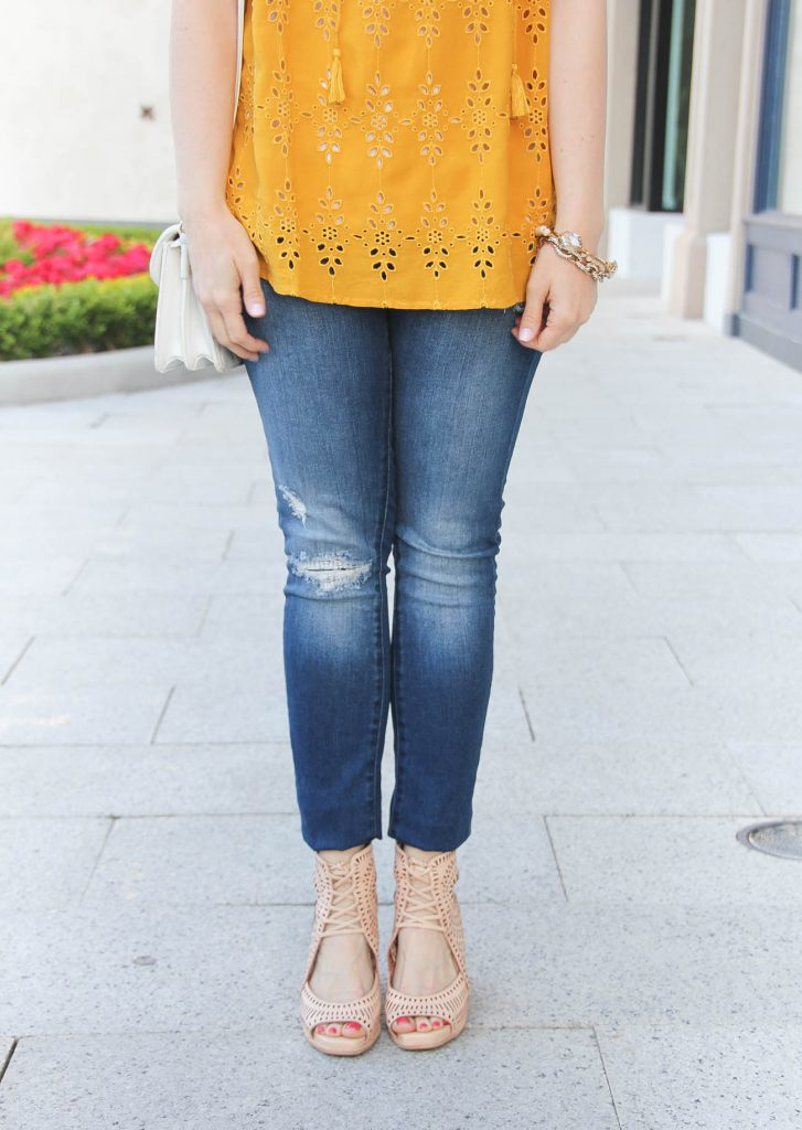 Houston fashion blogger Lady in Violet shares summer outfit ideas featuring distressed jeans and wedge sandals.