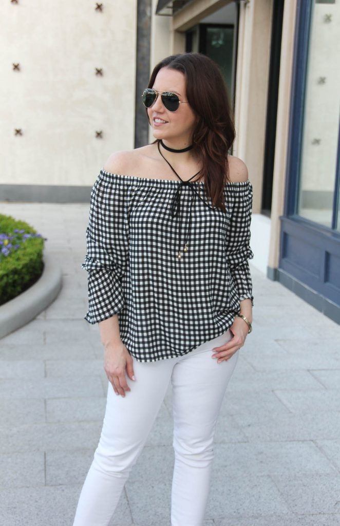Lady in Violet, a Houston based blogger, wears a spring weekend outfit idea including a gingham off the shoulder top with white skinny jeans and a black choker necklace.