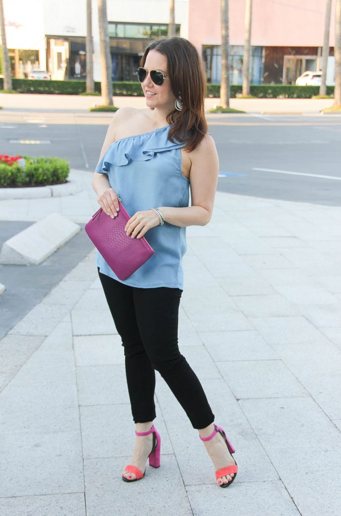 Lady in Violet, Houston fashion blogger, styles date night outfit idea including ruffle one shoulder top with black skinny jeans and pink heels.