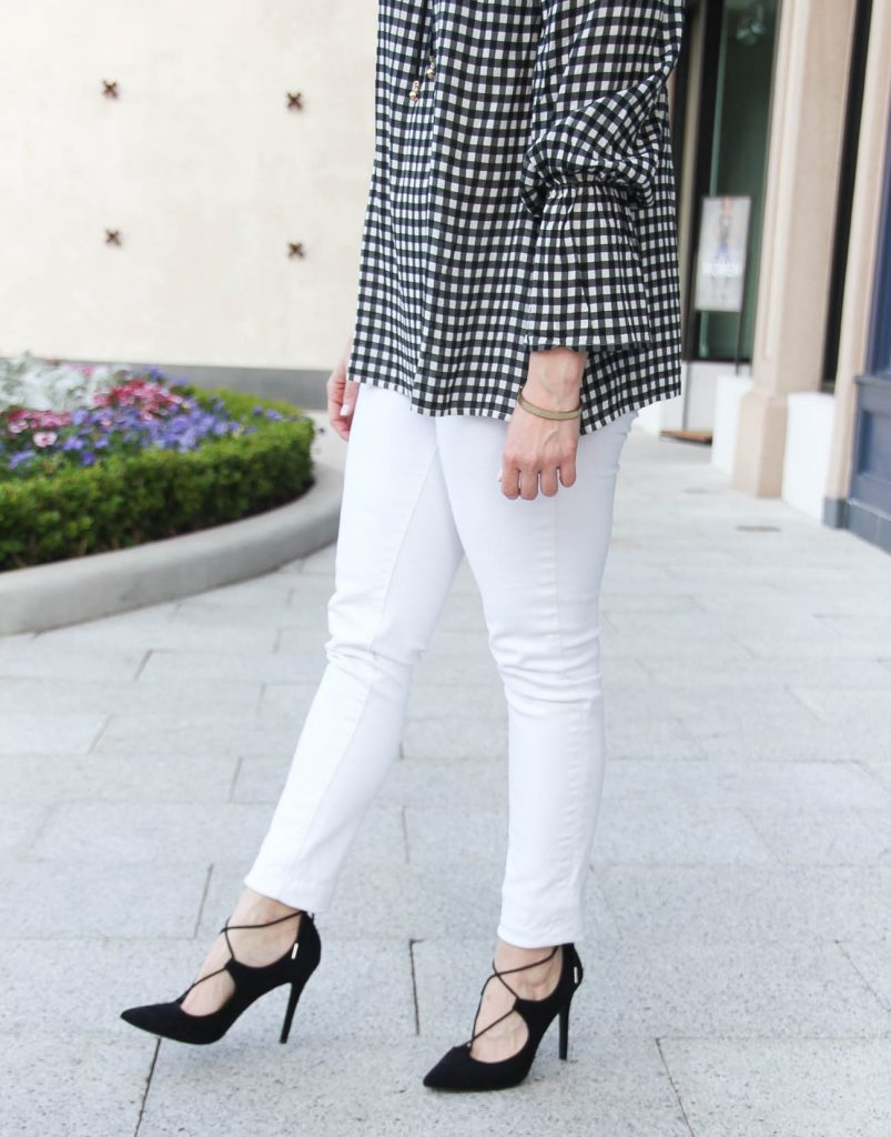 Karen Rock, a Houston fashion blogger, styles spring trends including white skinny jeans with a gingham bell sleeve top.
