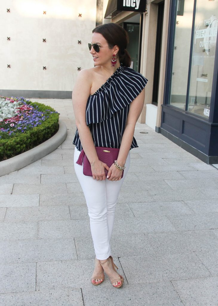 Houston style blogger wears a cute outfit idea for outdoor party with white jeans.