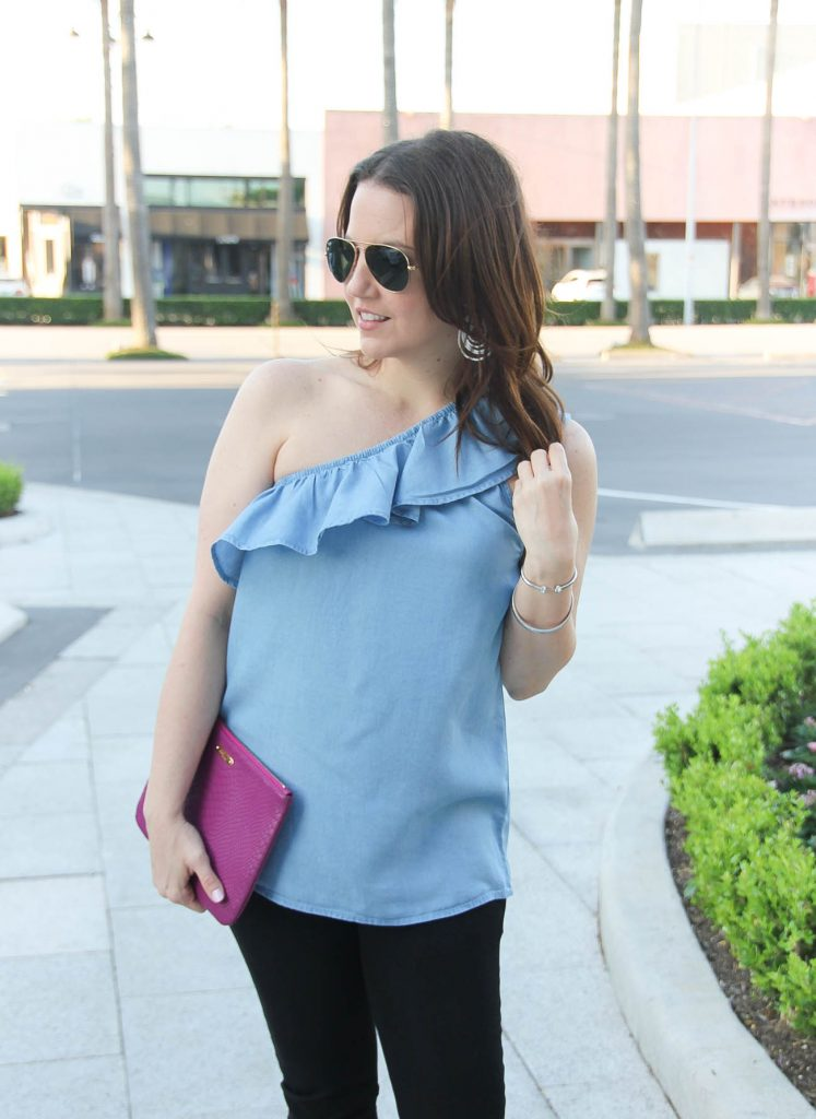 Blogger Lady in Violet styles spring outfit idea including chambray one shoulder top with black skinny jeans.