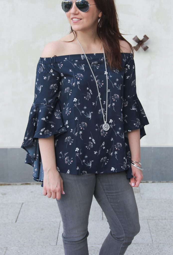 Houston based fashion blogger styles spring fashion trends including a bell sleeves off the shoulder top.