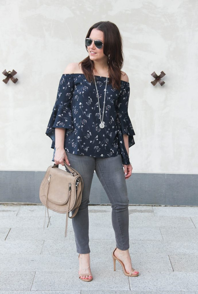 Houston fashion blogger wears spring trends including floral bell sleeve off the shoulder top with gray jeans and sandals.