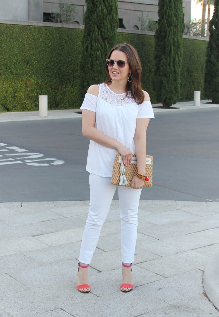 Houston fashion blogger wears white on white outfit for Spring featuring cold shoulder top with pink block heel sandals.