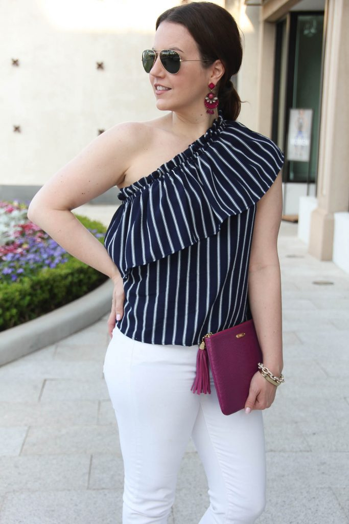 Houston fashion blogger wears chic spring outfit idea including a one shoulder top with white jeans.